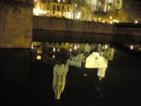 Girona-reflection in the river.jpg